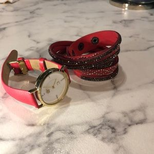Red watch with gold accents and faux wrap bracelet